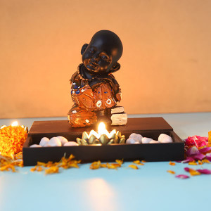 Buddha Monk Sitting With T Light Holder And Pebbles - Online Home Decor Items