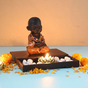Cute Buddha Monk Sitting With T Light Holder And Pebbles - Online Home Decor Items