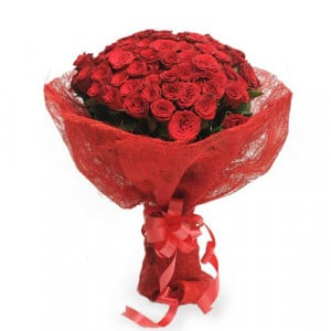 Roses In Jute Packing 50 Red Roses - Marriage Anniversary Gifts Online