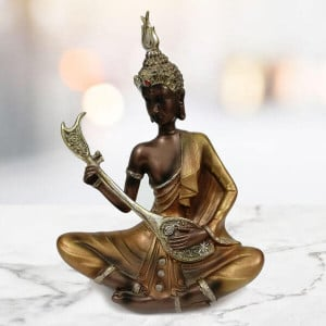 Beautiful Musical Lord Buddha Statue - Send Gifts to Zirakpur