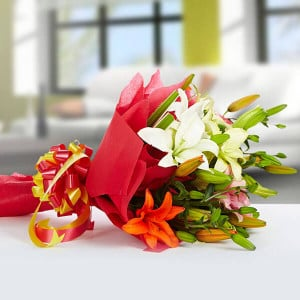 Exotic 12 Mix lilies - online flowers delivery in dera bassi