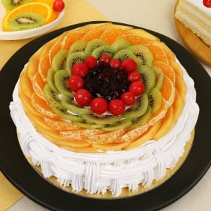 Pineapple And Fruits Cake Half Kg - Send Eggless Cakes Online