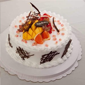 Pineapple With Fruits Cake Half Kg - Online Cake Delivery in Karnal